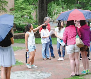 Rising junior Aliyah Cruz leads prospective students on a tour of UNC's campus in May 2016. The visitor's center has begun giving tours in spanish.