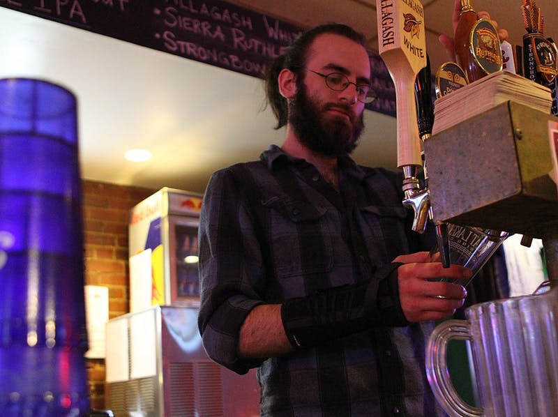Adam Kiihr works at Linda's Bar and Grill on Wednesday night.