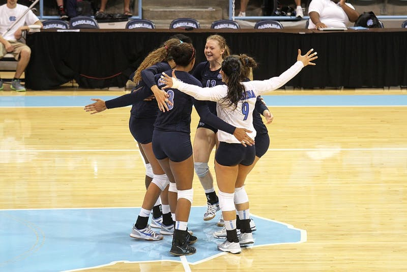 UNC's volleyball team embrace between plays during their match again Georgia Southern Saturday.  They would go on to win 3-0.