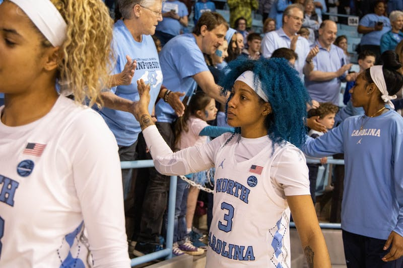 UNC redshirt senior Madinah Muhammed (3) high-fives fans after the game against Duke University in Carmichael Arena on Sunday, March 1, 2020. The Blue Devils beat the Tar Heels 73-54.