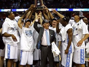 """Coach Roy Williams and the Tar Heels celebrate after winning the South Regional with a 72-60 victory against Oklahoma that punched UNC?s ticket to Detroit for this year?s Final Four. It?s the second in a row for UNC"""" and the team?s fourth showing in the semifinals in the past 10 years."""