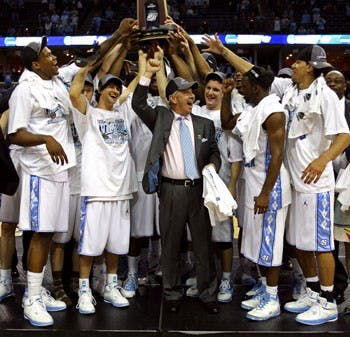 "Coach Roy Williams and the Tar Heels celebrate after winning the South Regional with a 72-60 victory against Oklahoma that punched UNC?s ticket to Detroit for this year?s Final Four. It?s the second in a row for UNC"" and the team?s fourth showing in the semifinals in the past 10 years."