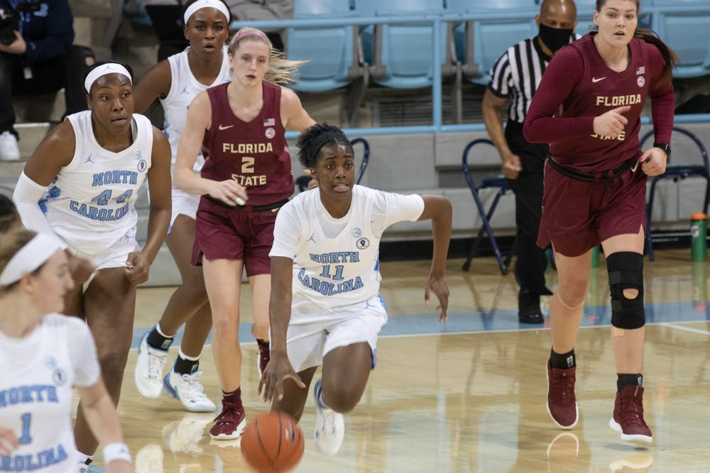 UNC redshirt sophomore guard Ariel Young (11) dribbles the ball up-court  off a fast break against Florida State on Thursday, Feb. 4, 2021. UNC fell to Florida State 61-51.