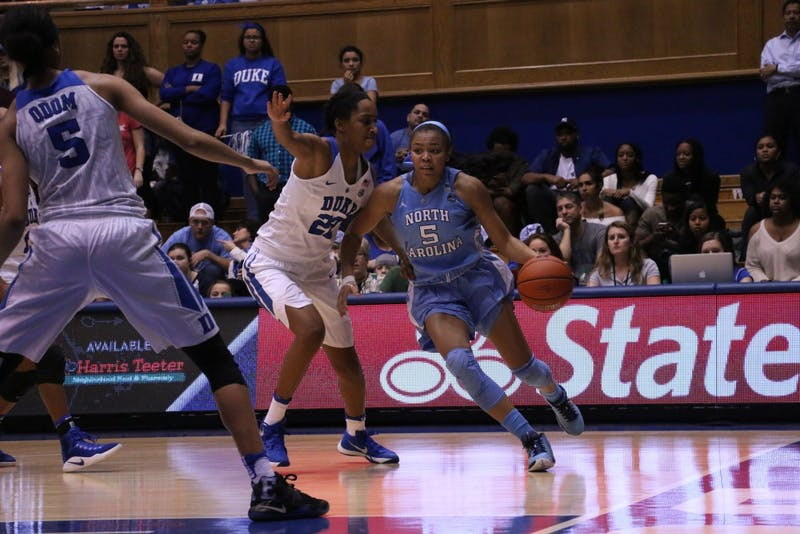 UNC sophomore guard Stephanie Watts (5) dribbles along the baseline at Cameron Indoor Stadium. The Tar Heels lost 70-58 to No. 12 Duke on Thursday.