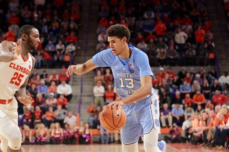 North Carolina guard Cameron Johnson (13) drives to the basket against Clemson on Jan. 30 in Littlejohn Coliseum.
