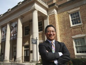 Emil Kang, Carolina's first Executive Director of the Arts, poses in front of Memorial Hall. Kang has pioneered the univeristy's recent artistic expansion.