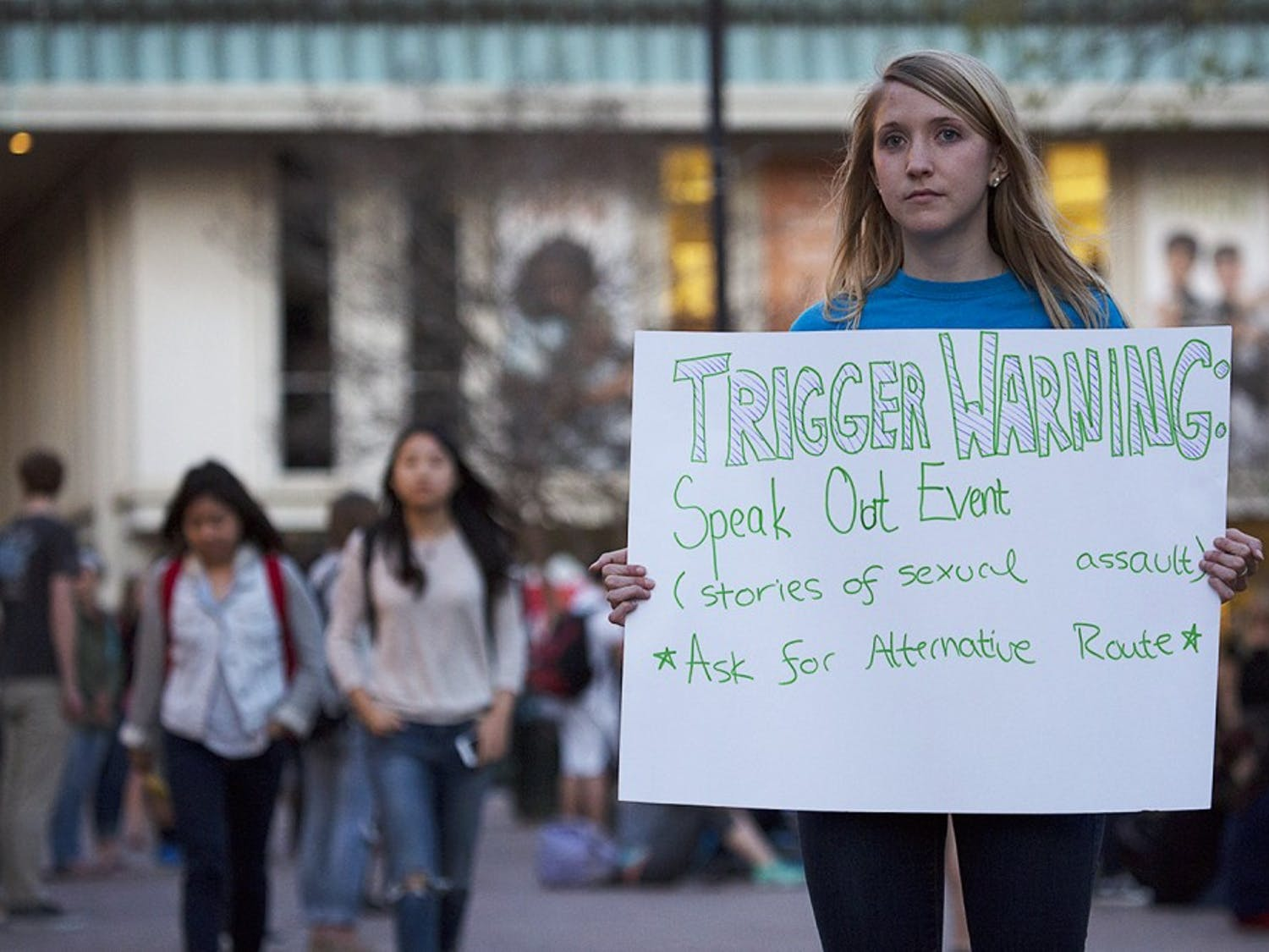 Alban Foulser directs students to Speak Out!, an event held in The Pit Tuesday evening by the Project Dinah organization. Members of the group read anonymous testimonials from survivors of sexual assault to students and onlookers.