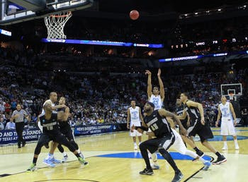 James Michael McAdoo hits a free throw to put UNC up two points to win the game. UNC defeated Providence 79-77 in the second round of the NCAA tournament at the AT&T Center in San Antonio, TX. The Tar Heels advance to play in the third round on Sunday.