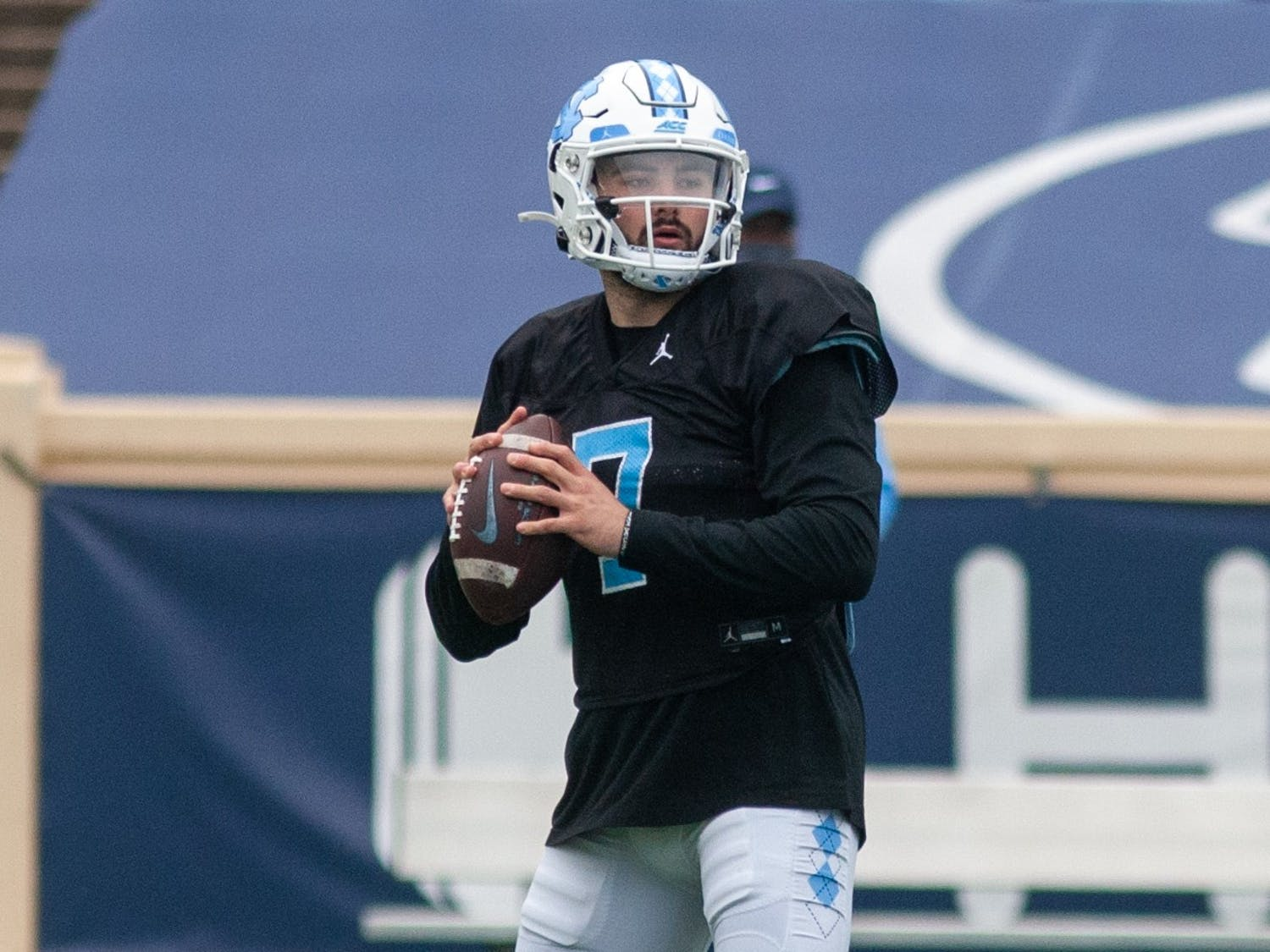 Sophomore quarterback Sam Howell (7) prepares to throw the ball at the football practice on Saturday Mar. 27, 2021 at Kenan Stadium.