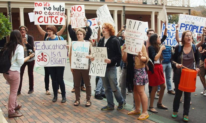 Students in protest of tuition hikes arrive at  the The Carolina Inn for the Board of Trustees Meeting.
