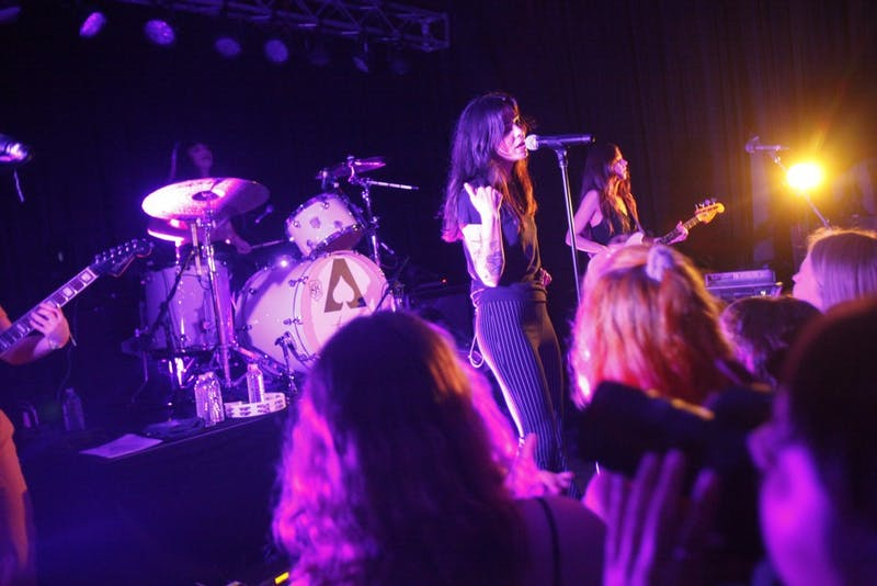 "The Aces, an all girl band from Provo, Utah, performed a sold out show in Cat's Cradle's Back Room on Sunday, February 24, 2019. The Aces have an infectious energy that lit up the entire venue. During the show Cristal Ramirez, the band's lead singer asked one of the fans in the crowd to say ""Carrboro"" for her so she would not mess up the pronunciation. During their song ""Volcanic Love"" fans held up hand made flowers over their phone flashlights and swayed along with the song. The Aces' sold out show was filled up with fans of all ages and the band made an effort to make every member of the audience a part of the show."