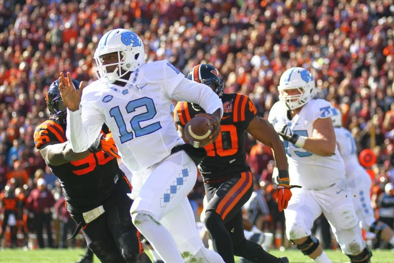 Quarterback Marquise Williams (12) runs the ball towards the end zone. Williams had one touchdown on Saturday against Virginia Tech.