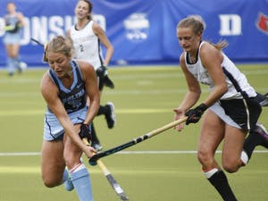 Senior midfielder Ashley Hoffman (13) dribbles the ball during the ACC Championship at Karen Shelton Stadium on November 4, 2018 where UNC beat Wake Forest 7-2. Hoffman was named ACC Defensive Player of the Year and was named MVP of UNC's field hockey team this season. Hoffman one both of these awards last year as well.