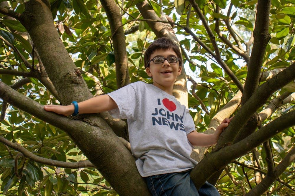 John Wortman, creator of John News on Youtube, poses for a portrait while climbing a tree on Sunday, Oct. 4, 2020.