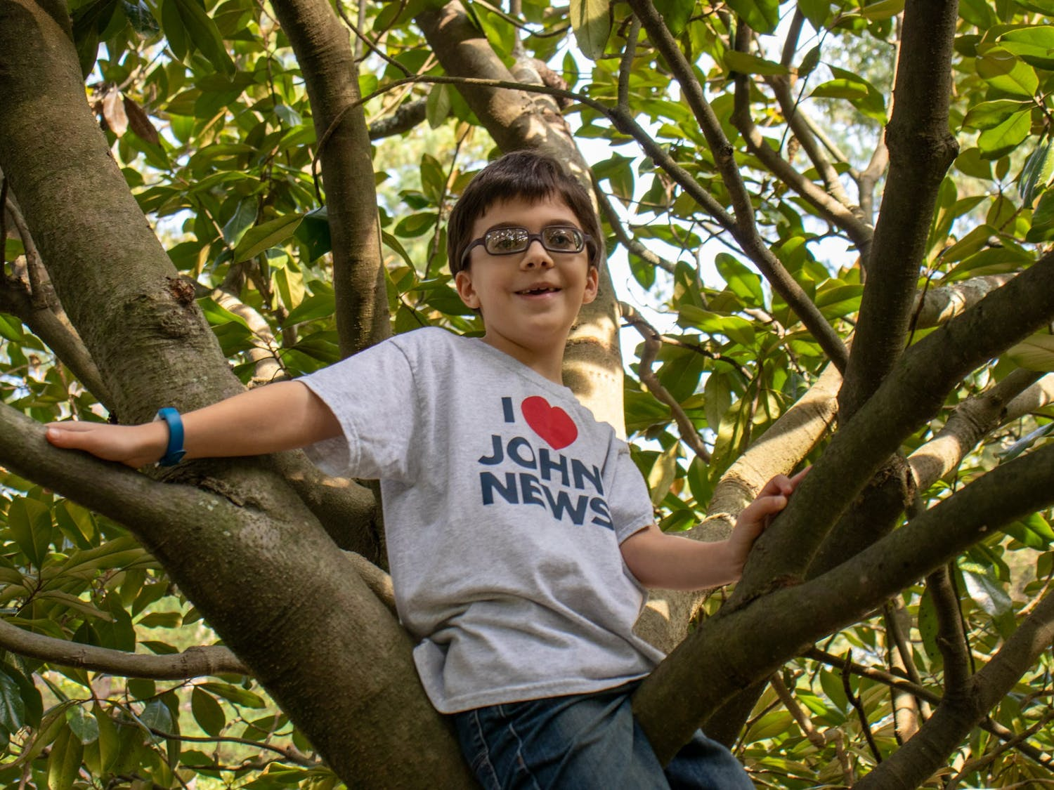 John Wortman, creator of John News on Youtube, poses for a portrait while climbing a tree on Sunday, Oct. 4, 2020.