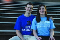 Stephanie DeFazio, a senior, and Joe Hendricks, a first-year law student at Duke University, on the bleachers at Fetzer Field. DeFazio and Hendricks met at He's Not Here in September.