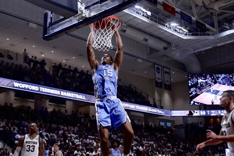 NC power forward Garrison Brooks (15) slam dunks the ball against Wofford in their first game of the season. UNC won 78-67 in the Richardson Indoor Stadium, Spartanburg, SC on Nov. 6, 2018.