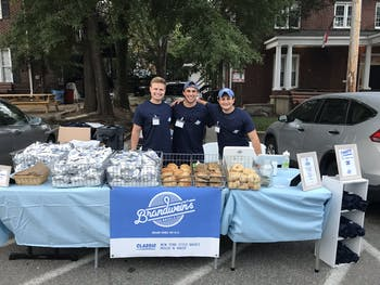 Alex Brandwein, on the far right, hold a Brandwein's Bagels pop-up event on Fraternity Court on Sept. 11, 2019. Photo courtesy of Alex Brandwein.