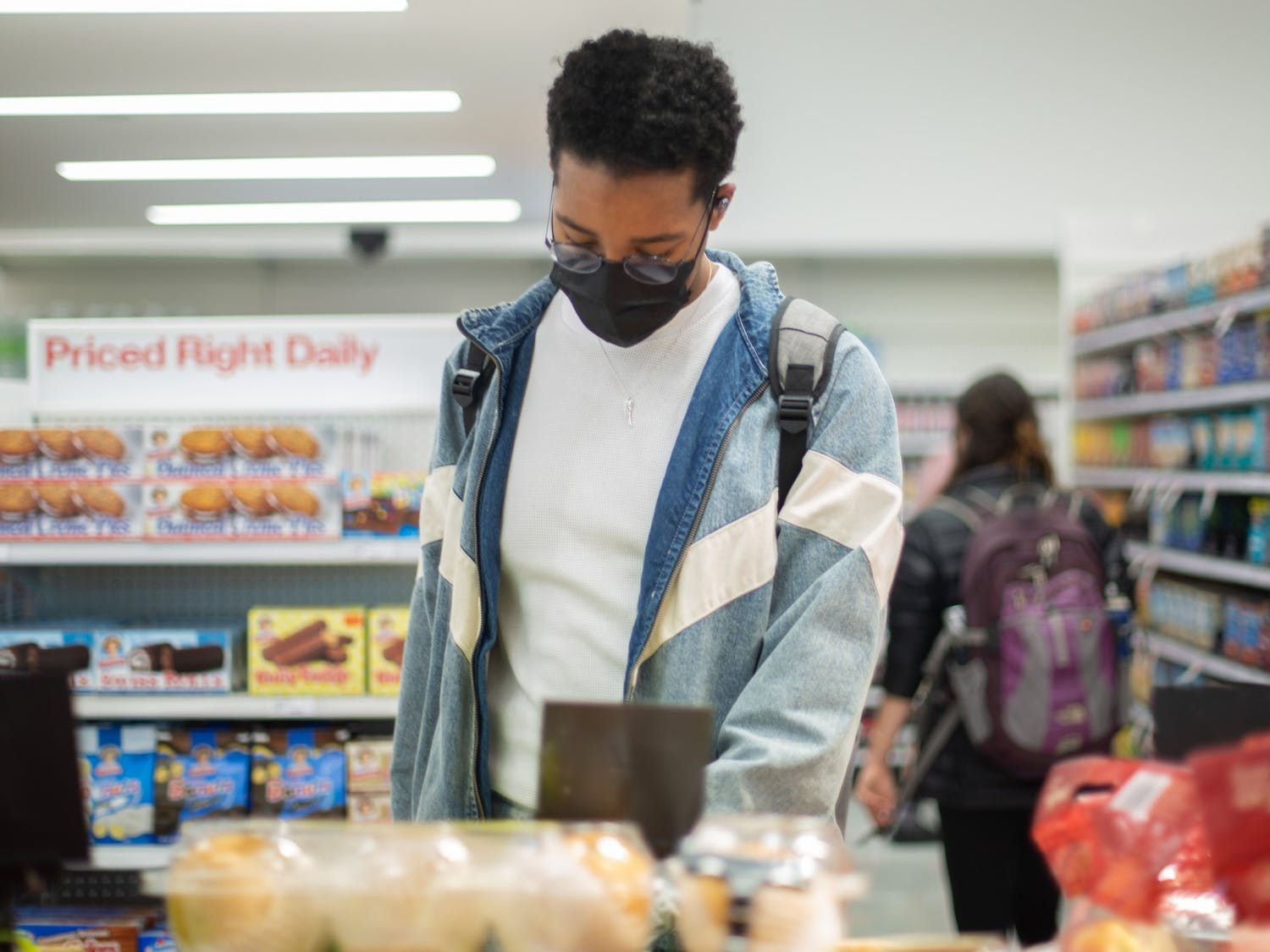 First-year computer science major Kendall Howard shops for food at the Target on Franklin Street on Friday, March 19, 2021.