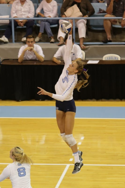 Redshirt senior Taylor Fricano (5) jumps for a hit against LIU Brooklyn on Sept. 8 in Carmichael Arena