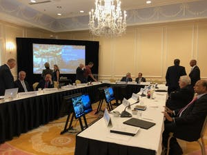 Members of the UNC Board of Trustees gather before the reconvening of the open session of the board's Dec. 3 meeting, where Chancellor Folt set forth the board's proposal for the future of Silent Sam.