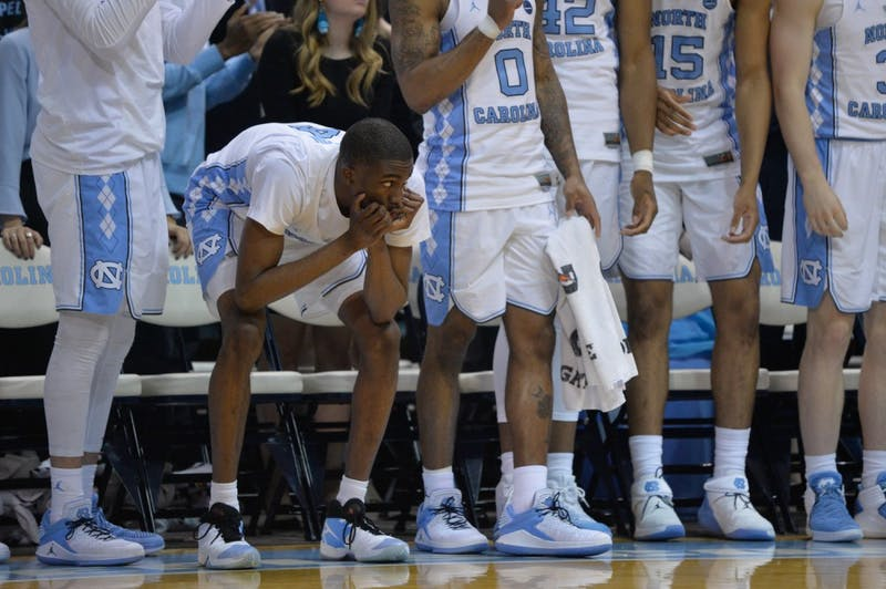 Sophomore guard Brandon Robinson (4) watches the second half anxiously from the bench on Feb. 27 at the Smith Center.