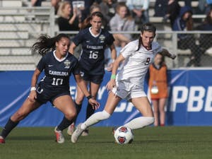 First-year midfielder Rachel Jones (10) fights for the ball against FSU first-year midfielder Kirsten Pavlisko (9) during the NCAA Championship game at WakeMed Soccer Park on Sunday, Dec. 2, 2018. UNC lost 0-1.