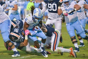 Sophomore Jordon Brown (2) carries the ball in a 2016 game against Virginia.