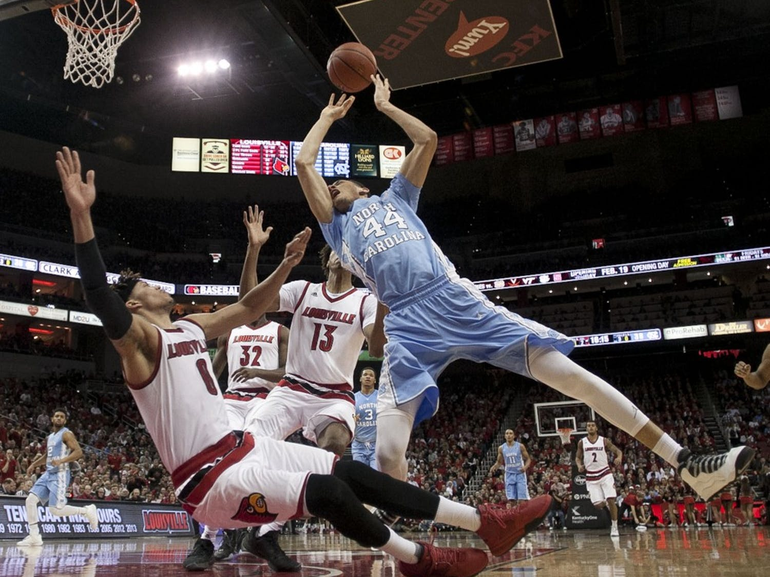 North Carolina's Justin Jackson (44) drives to the basket against Louisville's Damion Lee (0) on Monday, Feb. 1, 2016, at the KFC Yum! Center in Louisville, Ky. (Robert Willett/Raleigh News & Observer/TNS)