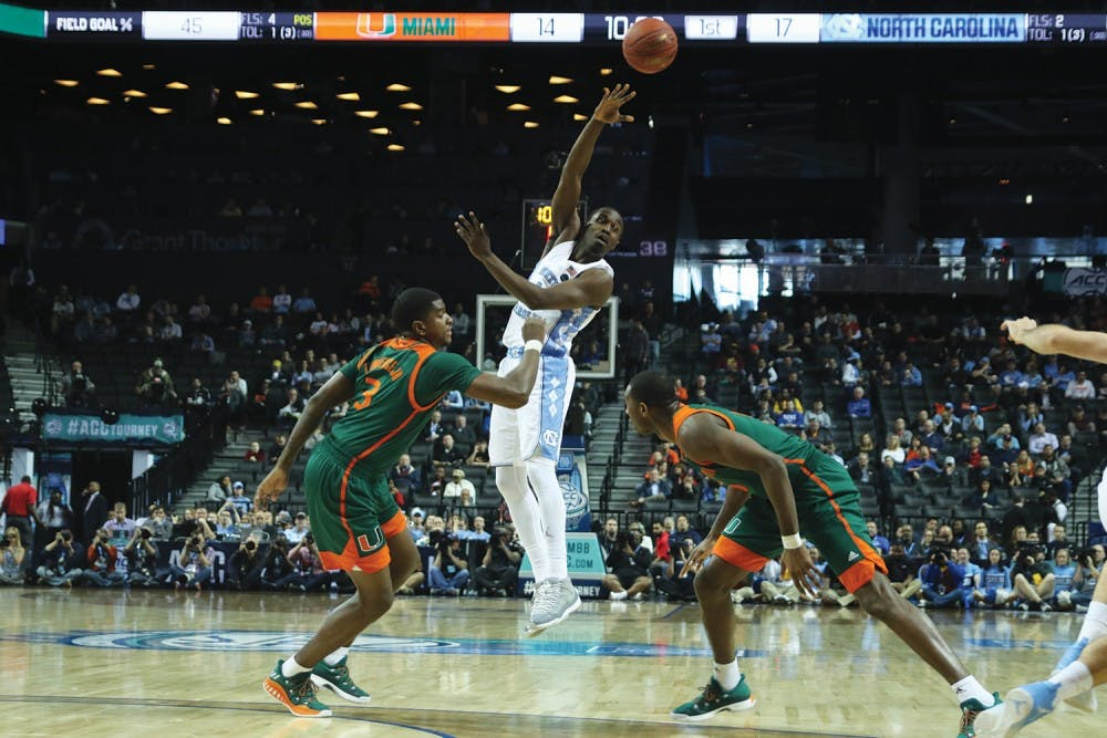 <p>North Carolina wing Theo Pinson (1) throws a pass over Miami defenders in the quarterfinals of the ACC Tournament in Brooklyn, N.Y. on Thursday.</p>