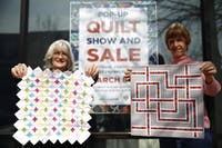 Patti Postage (left), the president of the Durham-Orange Quilters Guild (DOQ), and Gwen Konsler (right), the advertising chair of the DOQ, hold two handmade quilts. The DOQ will be holding a pop-up quilt show at 109 E Franklin Street during the week of March 3.