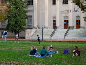 Students gather on the quad, socially distanced, in front of Wilson Library on Saturday, Nov. 14, 2020.