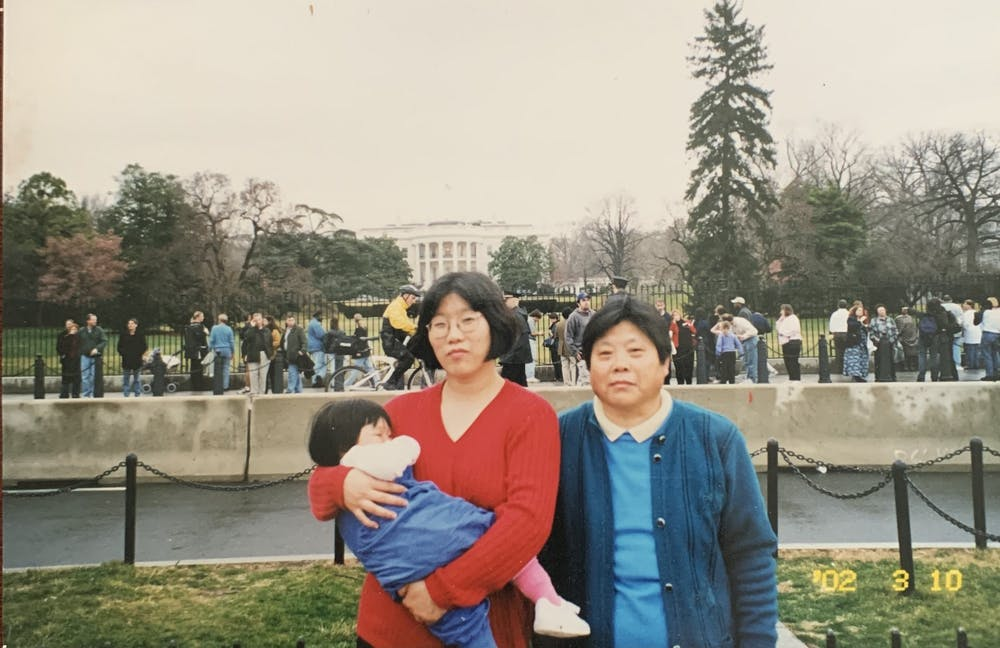 <p>A 1-year-old Victoria Song with her mother and grandmother during a trip to Washington, D.C. in 2002. Photo courtesy of Victoria Song.</p>