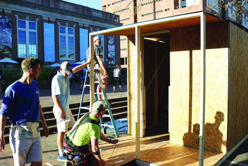 Romeo Antolini (left), Chase Jarvis, Staff Sgt. Christopher Brantley and Riley Head build a shack in the Pit for Carolina Blueprint, a weeklong fundraiser.