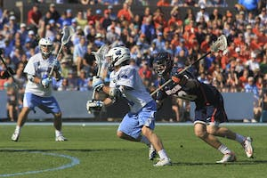 Joey Sankey (11) attempts a goal in the second half of Saturday's game. Sankey is now UNC's all-time leading scorer after beating Syracuse.