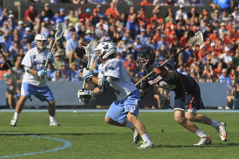 Senior Joey Sankey attempts a goal in the second half Saturday afternoon. Sankey became UNC's all-time leading scorer after UNC defeated Syracuse 17-15 at Fetzer field.