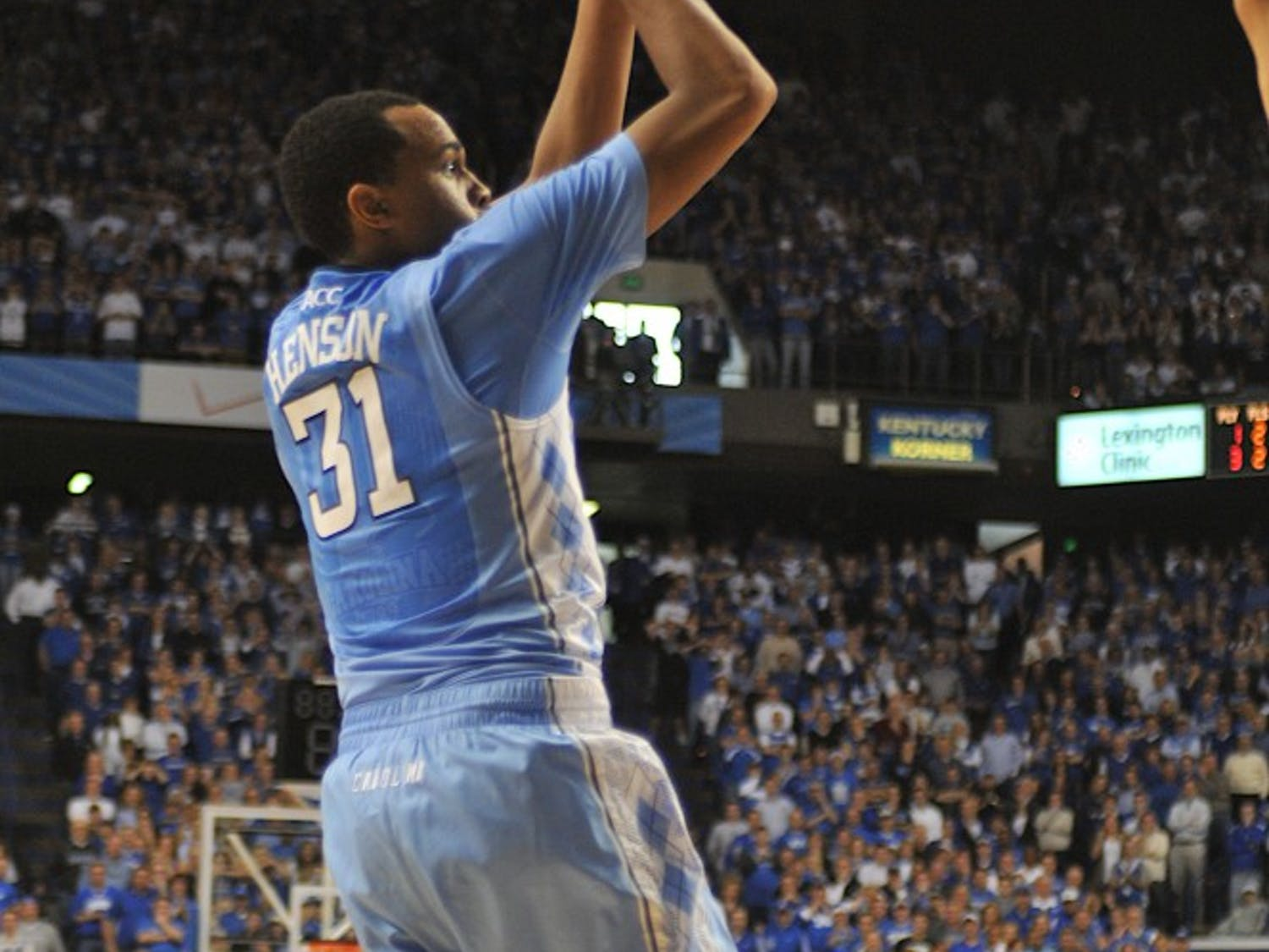 UNC forward John Henson attempts to shoot the ball over Anthony Davis in the final seconds of the game.