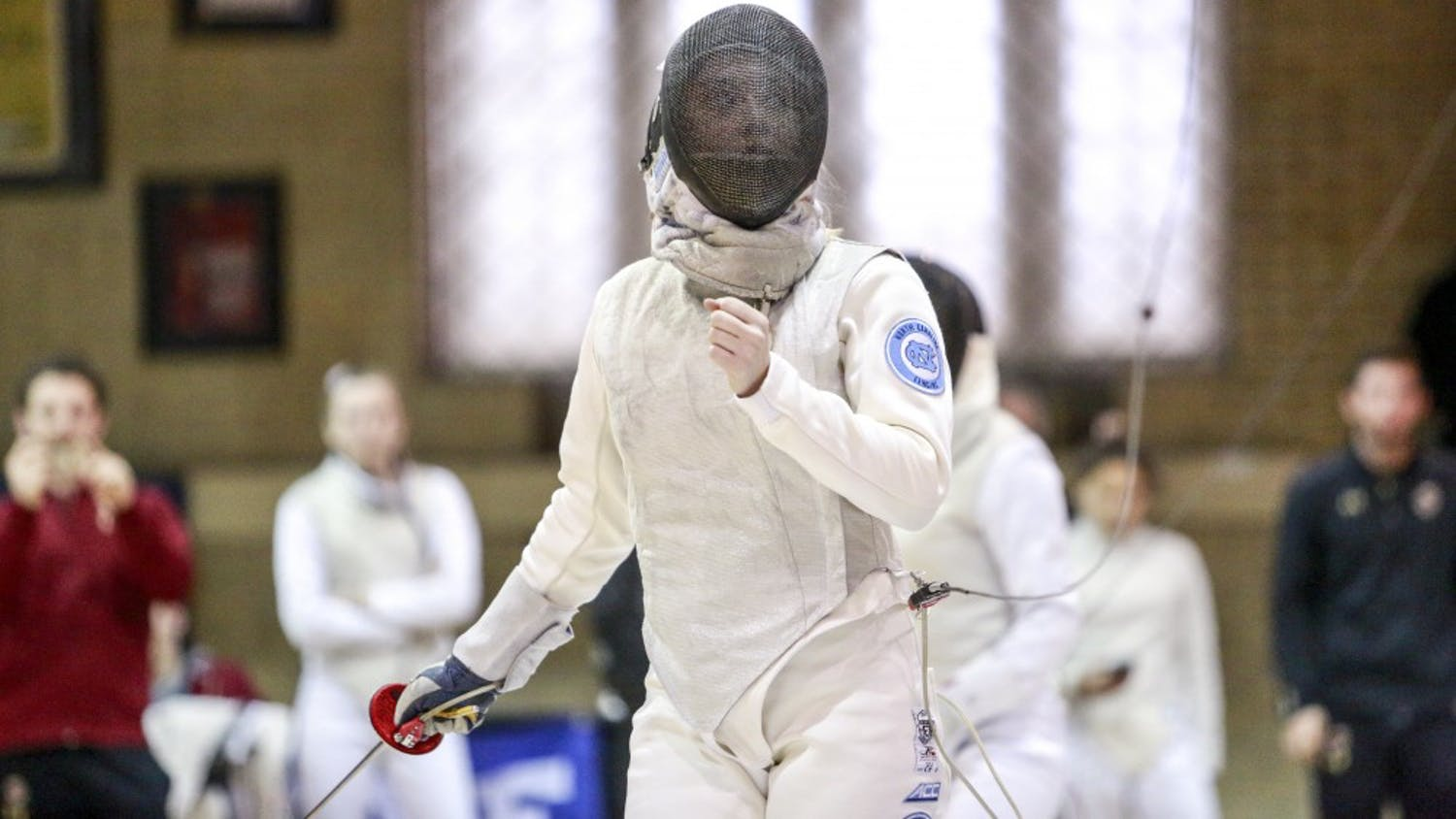 UNC's Sydney Persing fences with Boston College's Vivian Li during the women's fencing match in Card gym at Duke University on Sunday, Feb. 10 2018.