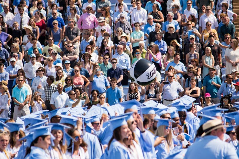 A class of 2018 beach ball is tossed during Commencement.