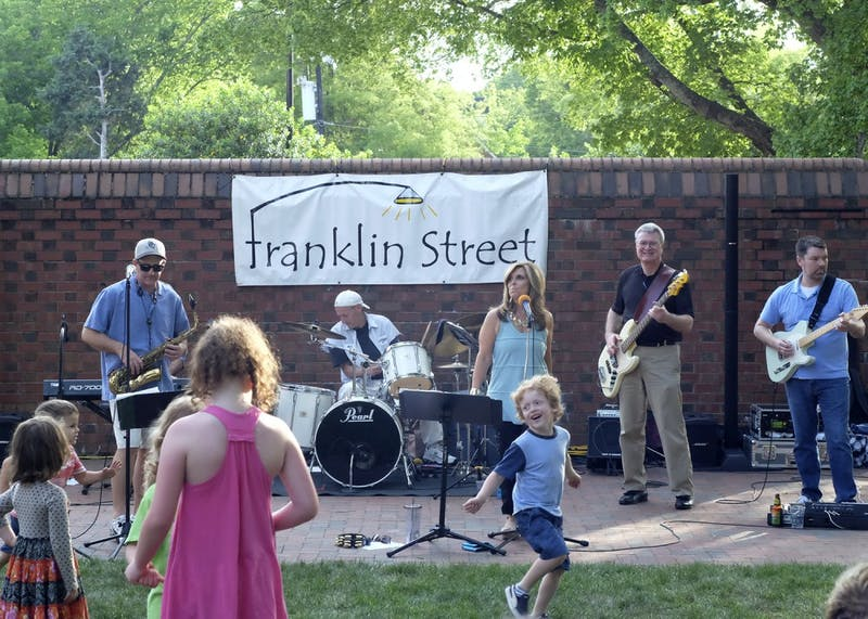 Mick Mixon & The Franklin Street Band perform in front of the Carolina Inn as a part of the Fridays on the Front Porch concert series.