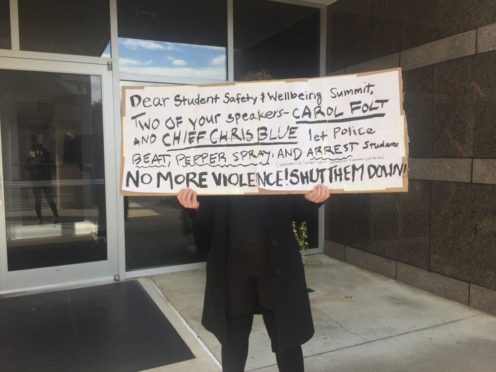 Protesters oppose Chancellor Folt, Chief Blue's inclusion in UNC summit on student safety
