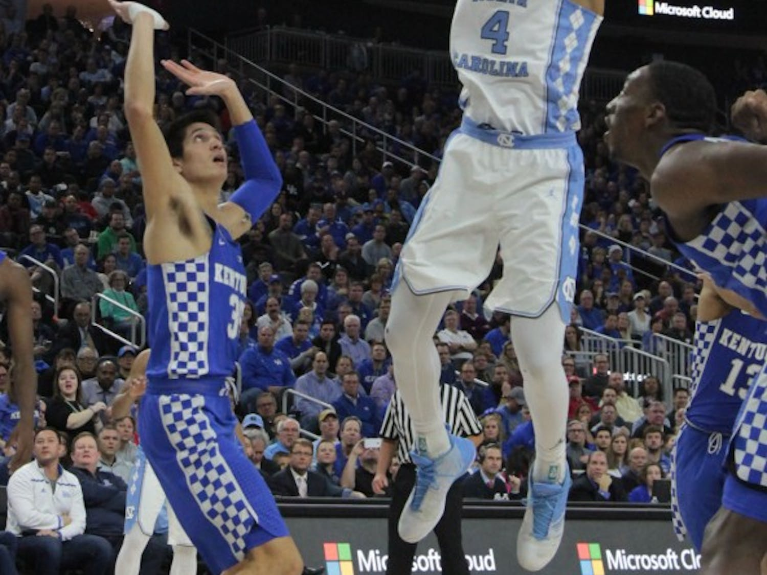 UNC forward Isaiah Hicks (4) goes for a contested shot against Kentucky at the CBS Sports Classic on Saturday.