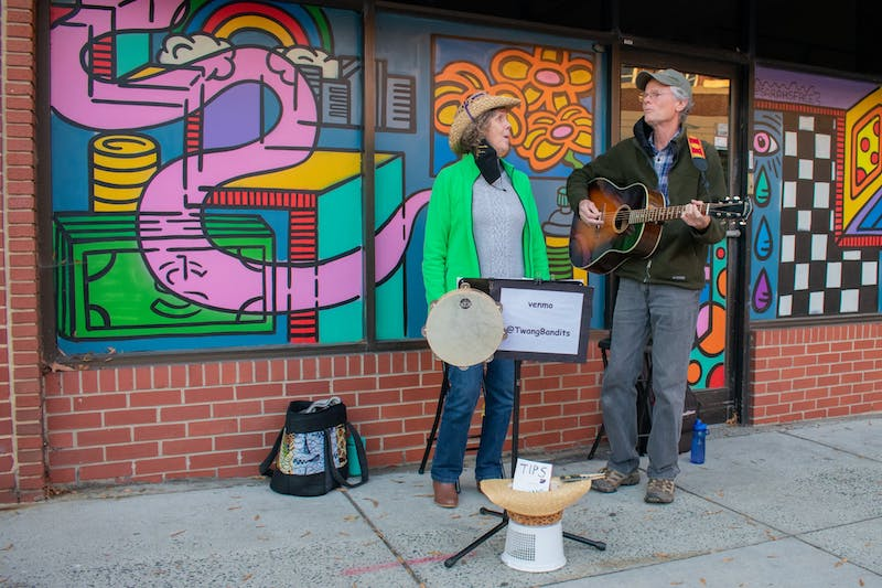 Catherine and Tony of the Twang Bandits play some classic country music on Franklin Street on Saturday, Oct. 17, 2020 for the Save The Music Series.