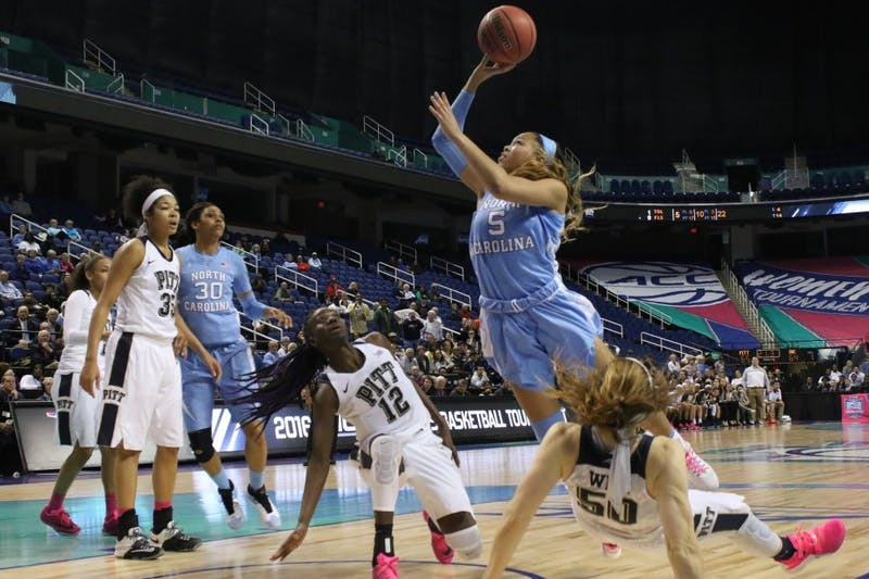 Carolina Guard Stephanie Watts (5) commits a charging foul in the final minute of the fourth quarter on Wednesday. The Carolina women's basketball team lost to the University of Pittsburgh 82-72 in the opening round of the ACC tournament.