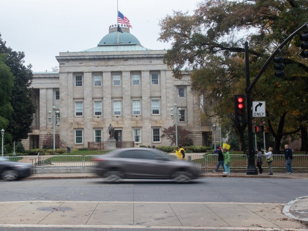 Cars pass by the North Carolina State Capitol building on Friday, Nov. 13, 2020. In the 2020 election, all of the incumbents in the council of state races won re-election or are leading over their opponent.