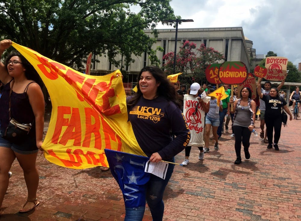 "<p>""Boot the Braids"" protestors march through the Pit to Wendy's. Photo courtesy of the&nbsp;Coalition of Immokalee Workers.</p>"