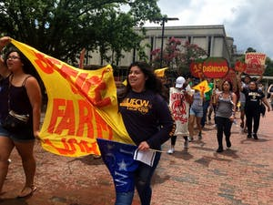 """""""Boot the Braids"""" protestors march through the Pit to Wendy's. Photo courtesy of theCoalition of Immokalee Workers."""