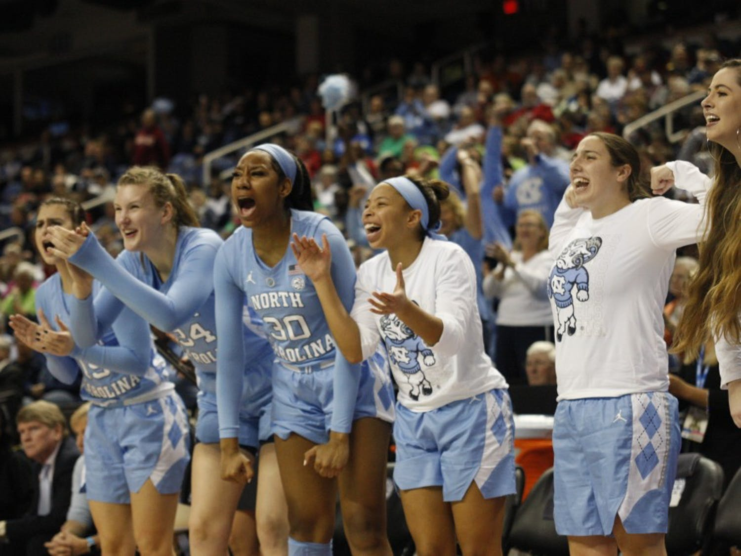 UNC women's basketball players cheer on their teammates from the bench during the second round of the ACC Tournament in Greensboro, N.C. on Friday, March 8, 2019. UNC lost to Notre Dame 95-77.