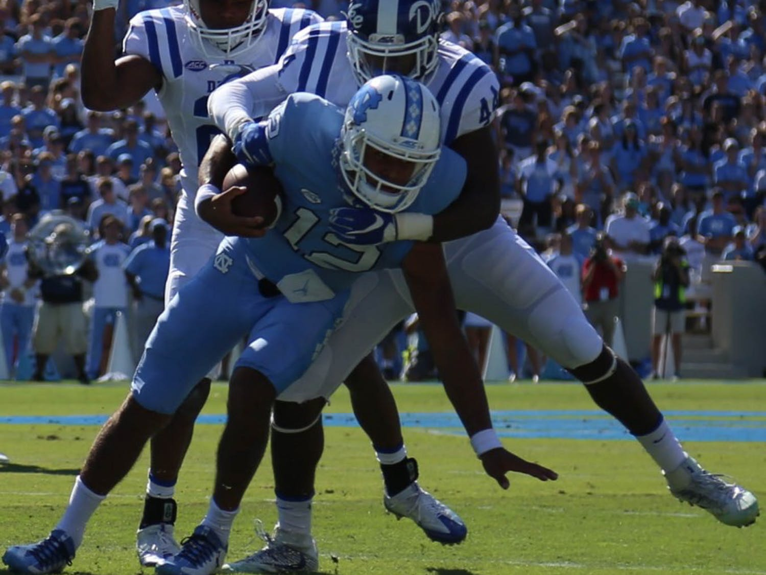 Quarterback Chazz Surratt (12) gets wrapped up by Duke defenders on Saturday.