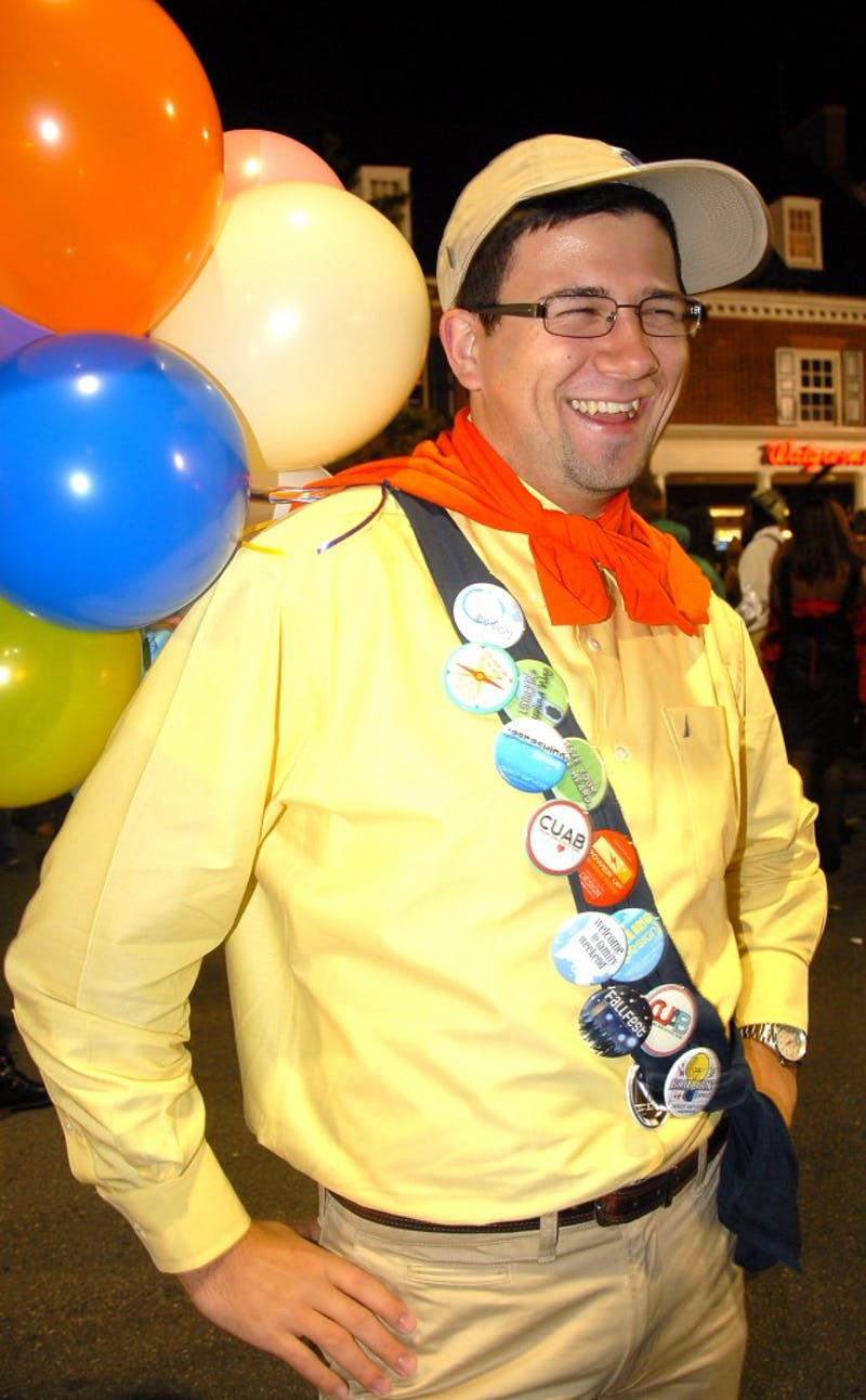 "Jesse Vineyard, a senior English major, poses as the character Russell from the movie ""Up."""